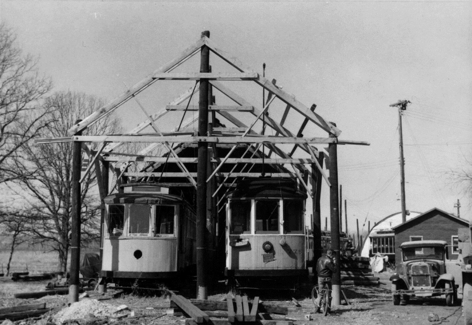Once the trolley cars were in position, they were actually used as scaffolds to construct each barn roof overhead. Incidentally, this photo shows Connecticut Co. cars 1602 and 775, both restored and carrying passengers on the Branford Electric Railway in 2014.